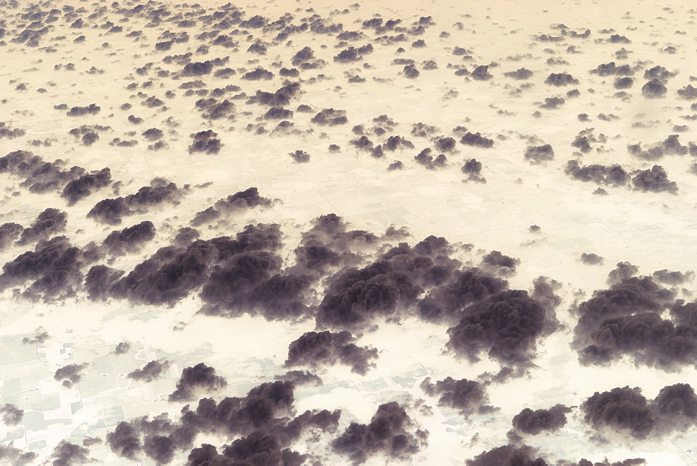 Aerial view of clouds above landscape.