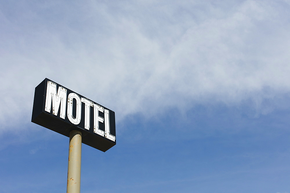 Motel sign against blue sky, near Maple Creek, Saskatchewan, Canada