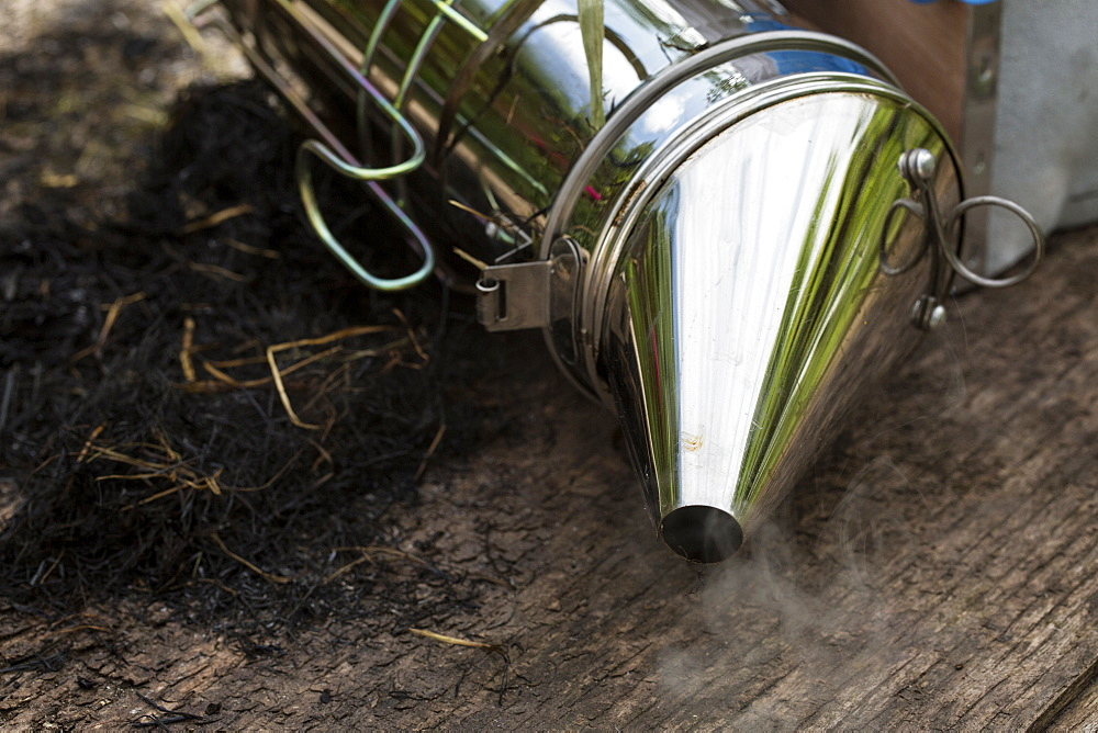 Close up of metal smoker used by beekeeper to calm bees, England, United Kingdom