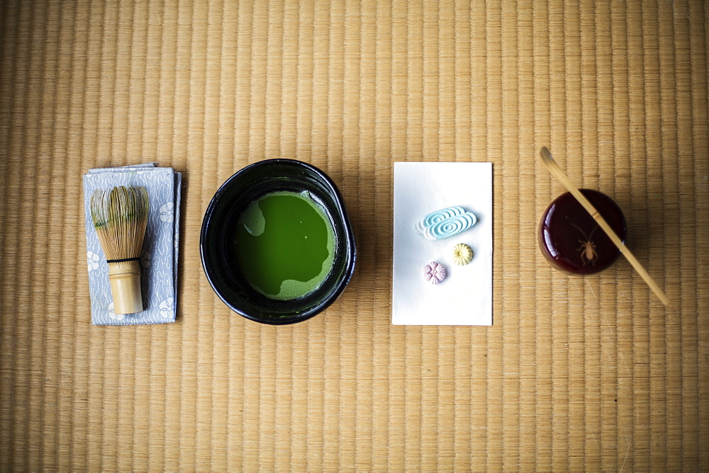Tea ceremony utensils including bowl of green Matcha tea, a bamboo whisk and Wagashi sweets, Kyushu, Japan - 1174-4887