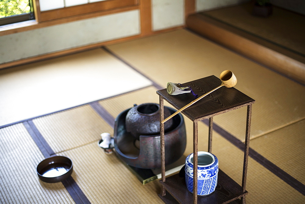 Traditional Japanese Tea Ceremony, high angle view of water container and small stand with a Hishaku, a bamboo ladle, on a tatami mat, Kyushu, Japan