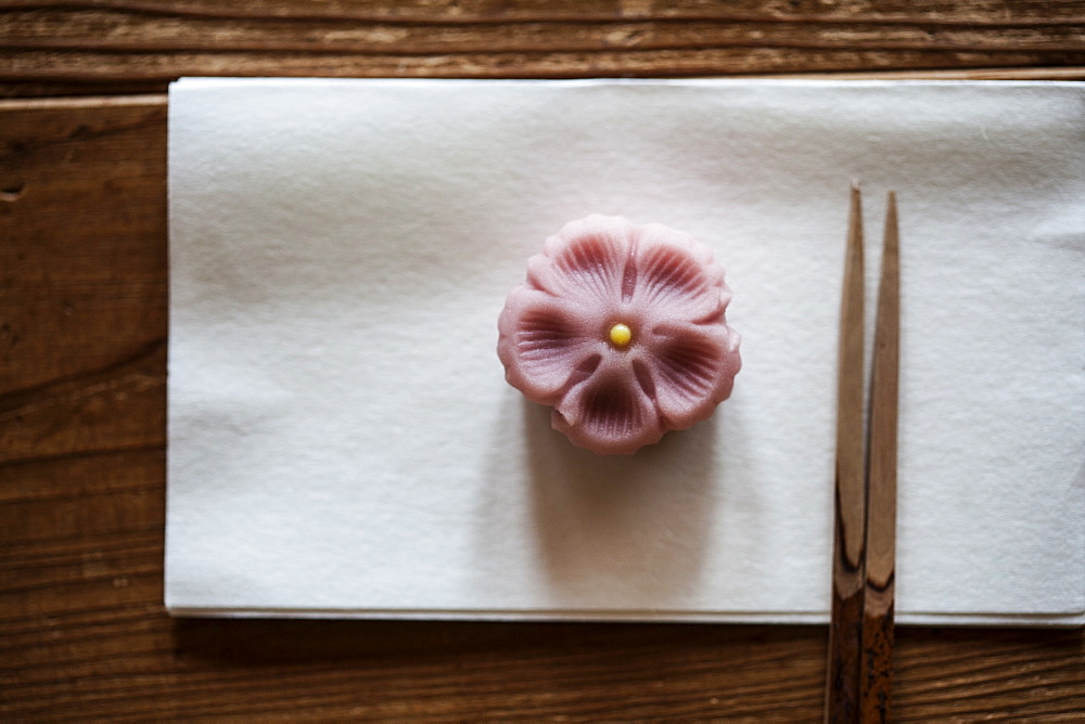 High angle close up of pair of chopsticks and Wagashi, a sweet traditionally served during a Japanese Tea Ceremony, Kyushu, Japan