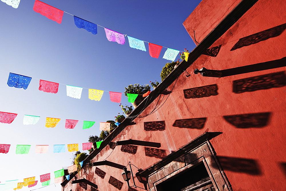 Multicolour banners against blue sky, San Miguel de Allende, Guanajuato, Mexico, San Miguel de Allende, Guanajuato, Mexico