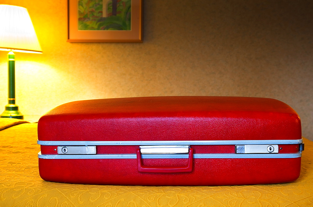 Red Suitcase in Motel Room, Santa Barbara, California, United States of America