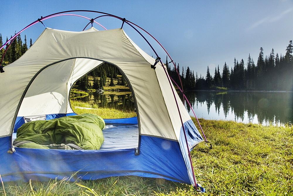 Tent at tranquil lakeside, Basin Lake, Washington, United States of America