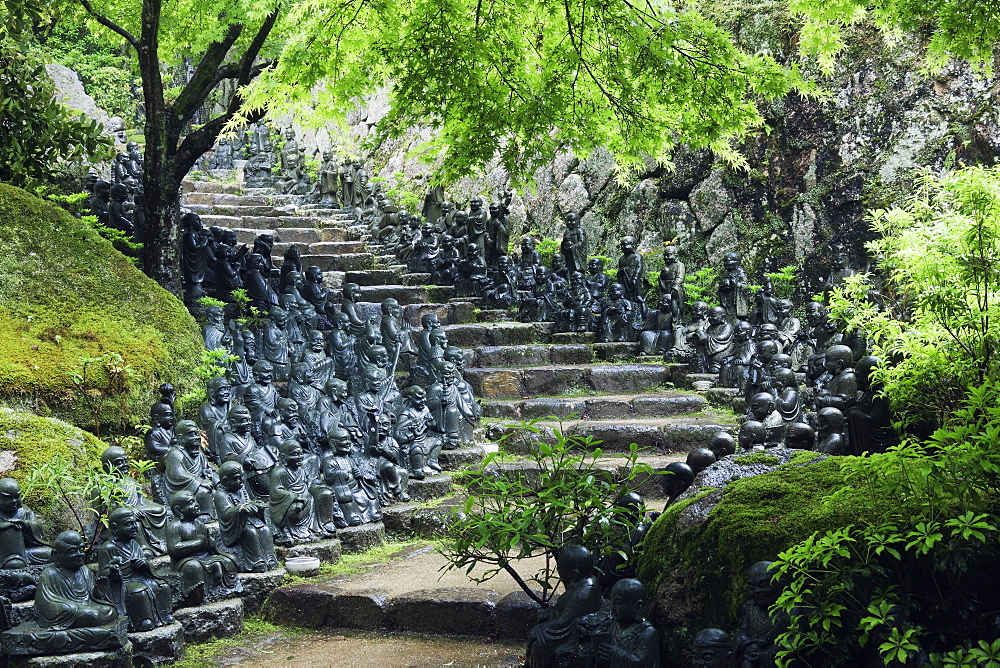 Statues lining steps in temple garden, Honshu island, Japan, Asia, Honshu island, Japan, Asia