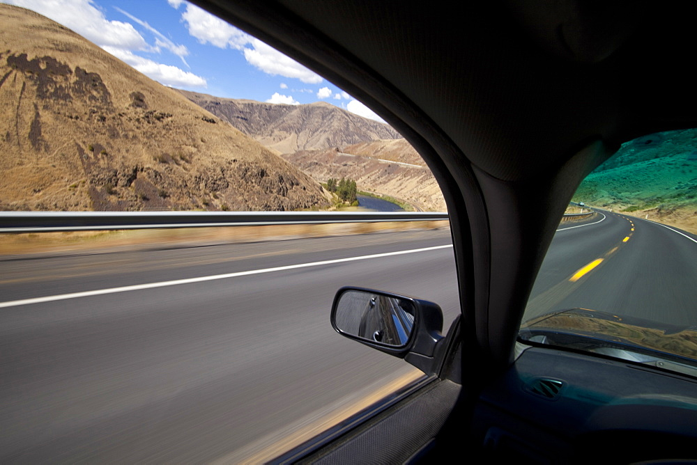 Car driving on road through Yakima River Canyon, Washington, United States, Yakima River Canyon, Washington, USA