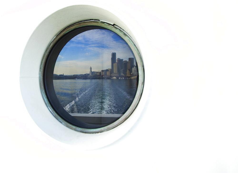 City skyline reflected in ferry porthole, Seattle, Washington, United States, Seattle, Washington, USA