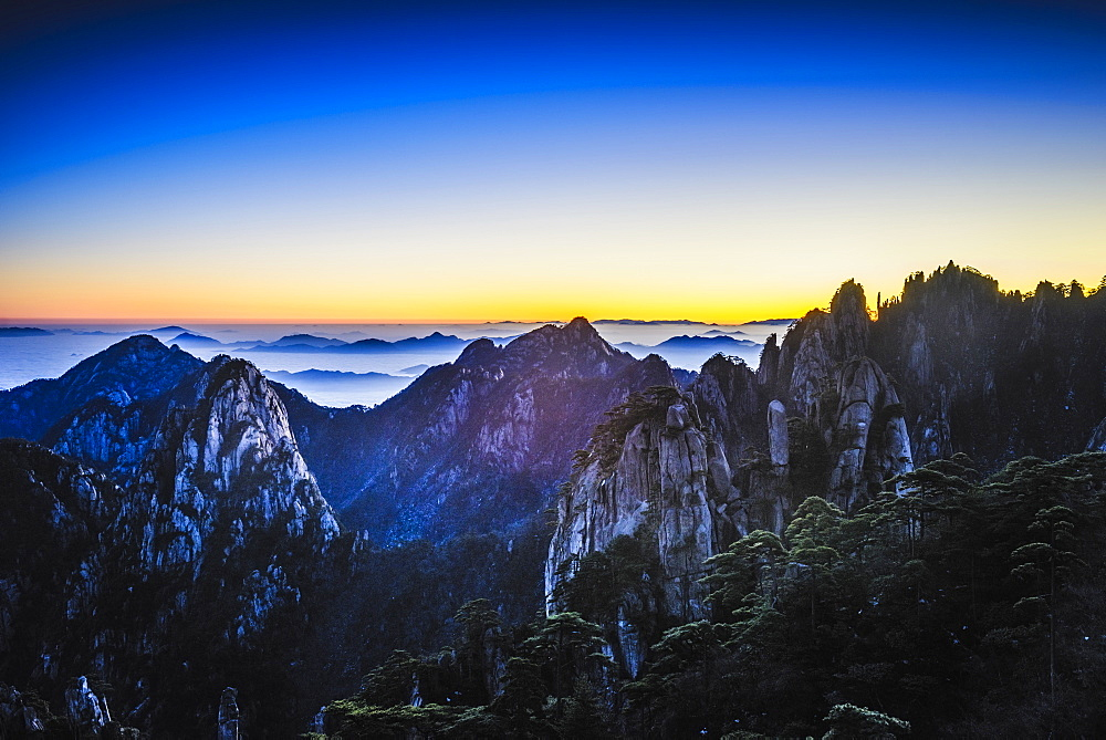 Clouds rolling over rocky mountains, Huangshan, Anhui, China, Huangshan, Anhui, China