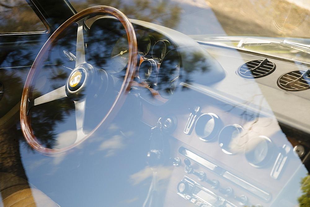 Vintage Ferrari dashboard viewed through window, Virginia Beach, Virginia, USA