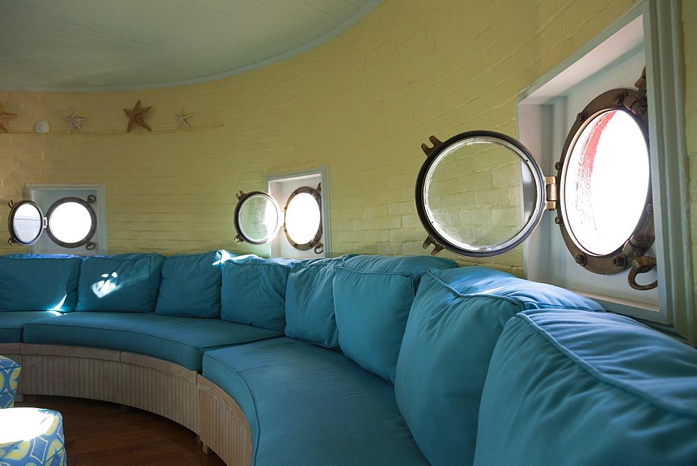 Port hole windows in round lighthouse living room, Newport News, Virginia, USA