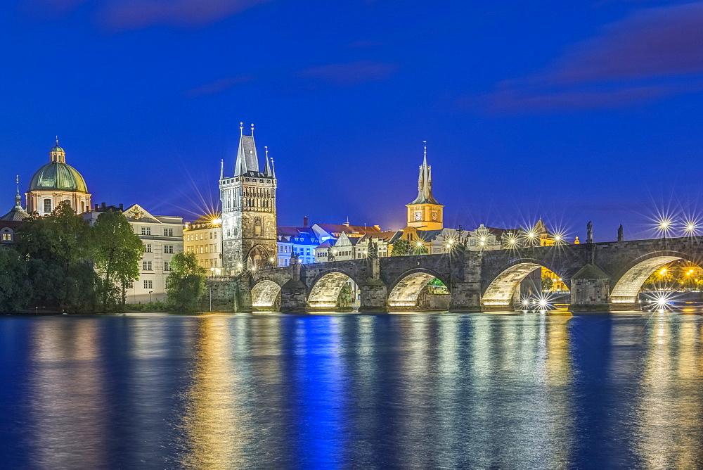 Charles Bridge and city illuminated at night, Prague, Czech Republic