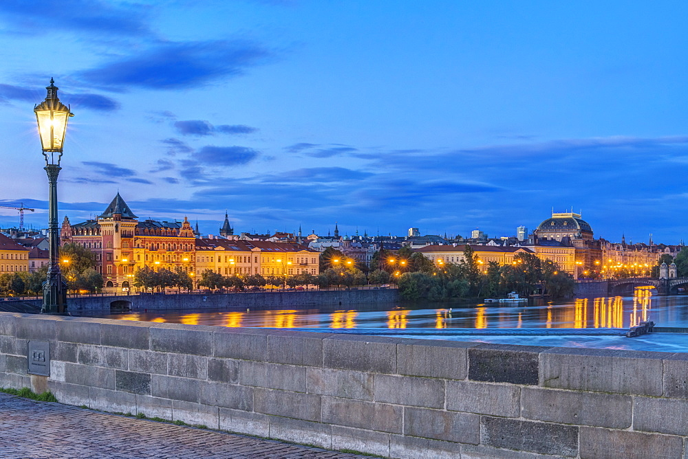 Charles Bridge and city illuminated at dawn, Prague, Czech Republic