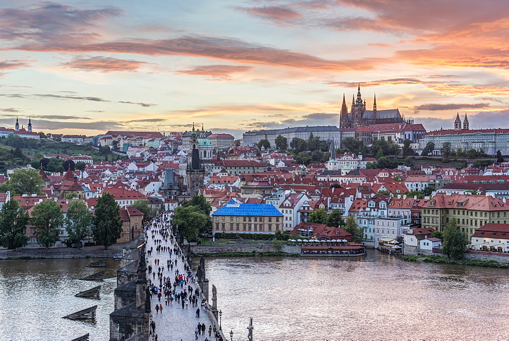 Charles Bridge, Prague Castle and cityscape at sunset, Prague, Czech Republic