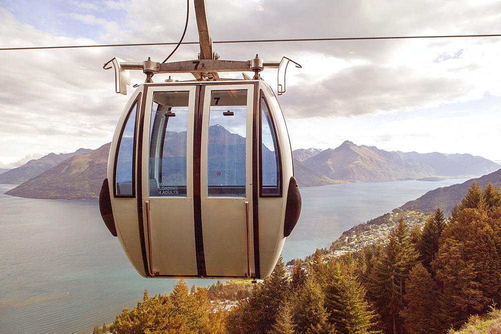 Ski lift overlooking mountain and lake