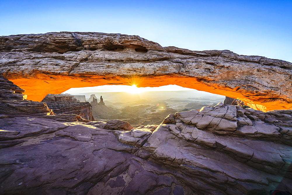 Sun rising over mesa arch, Canyonlands, Utah, United States