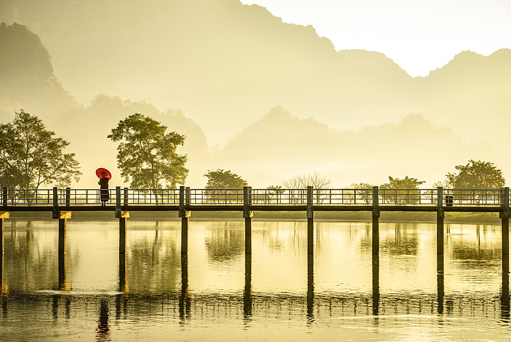 Mountains and bridge reflected in still lake, Hpa an, Kayin, Myanmar