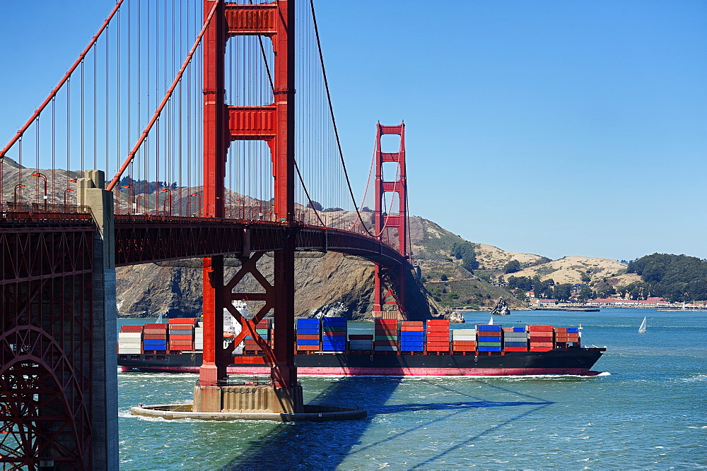 Barge passing under Golden Gate Bridge, San Francisco, California, United States