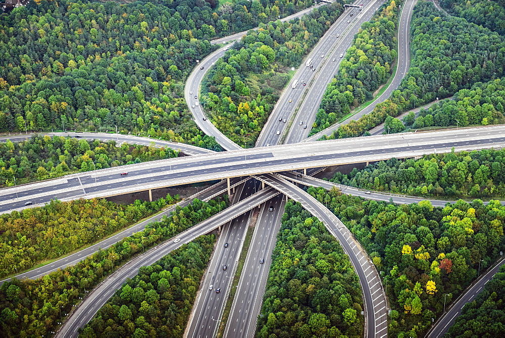 Aerial view of intersecting highways near trees, London, England - 1174-6177