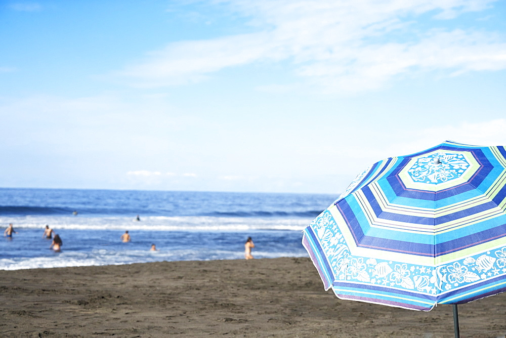 Umbrella on beach under blue sky, Tigaiga, Tenerife Canary Islands, Spain