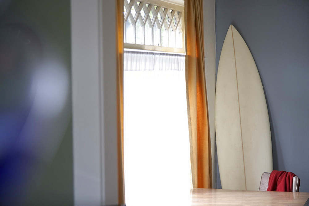 Surfboard and table at window, Seattle, Washington, USA