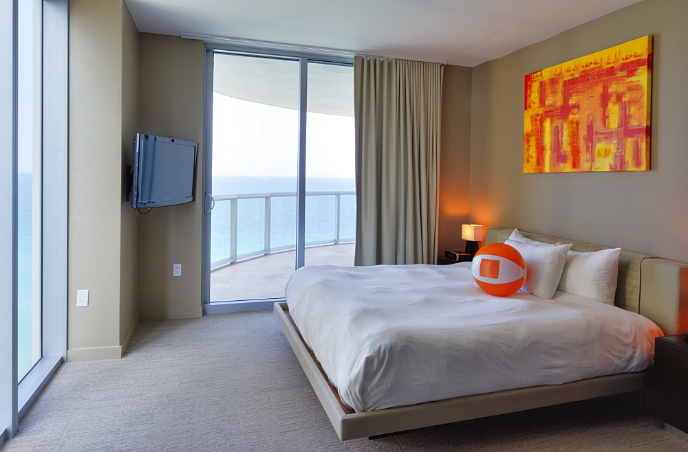 Beach ball on bed in hotel room, Miami, Florida, USA