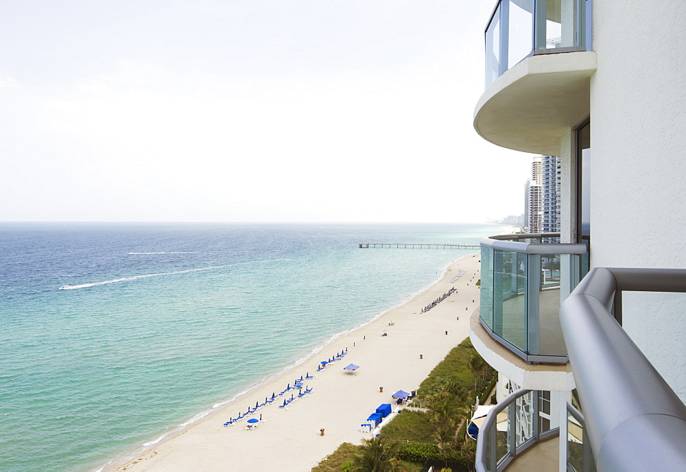 Hotel balcony overlooking urban beach, Miami, Florida, USA