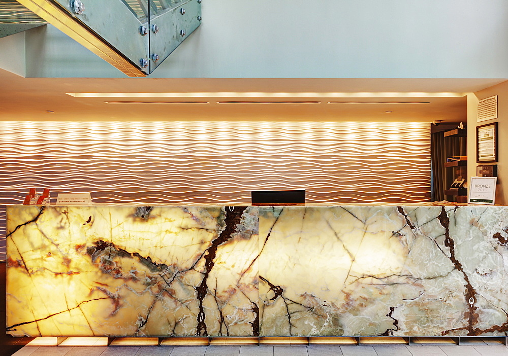 Marble reception desk in hotel lobby, Miami, Florida, USA