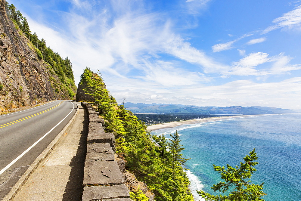 Empty road over beach coastline, Manzanita, Oregon, USA