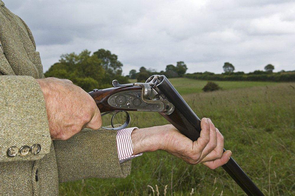 Man holding an open rifle, Gloucestershire, England