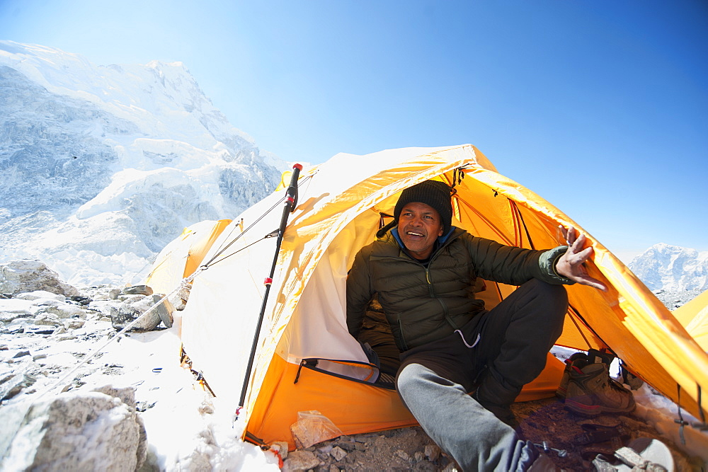 Man sitting in base camp tent, Everest, Khumbu glacier, Nepal, Everest, Khumbu glacier, Nepal
