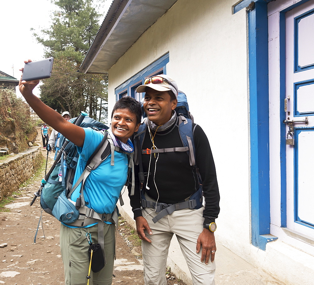Tourists posing for cell phone selfie, Lukla, Khumbu, Nepal