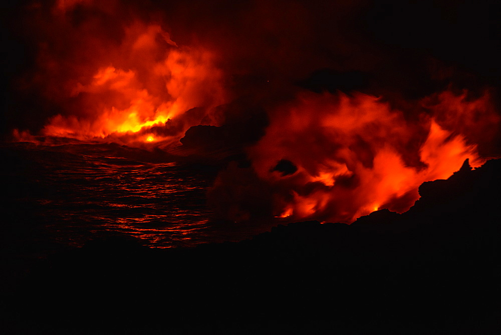 Smoke from molten lava at night, Big Island, Hawaii, USA