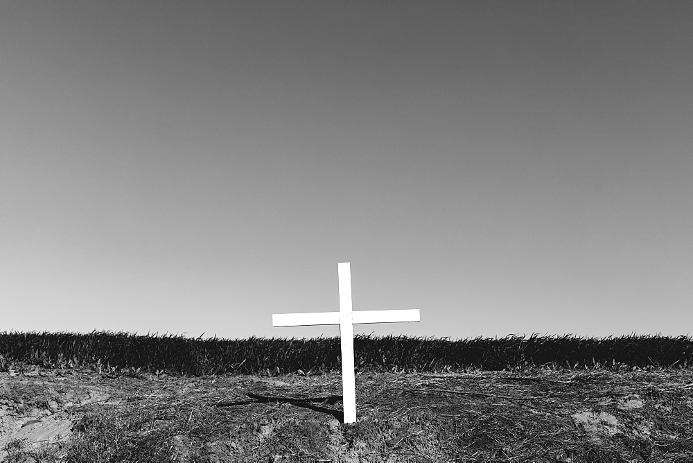 A cross on a hillside, a grave site in open country, Palouse, Washington, USA