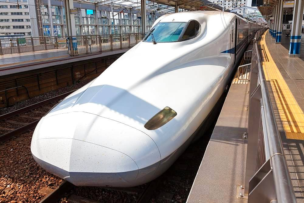 White Shinkansen Bullet Train waiting at a platform of Tokyo Station, Japan