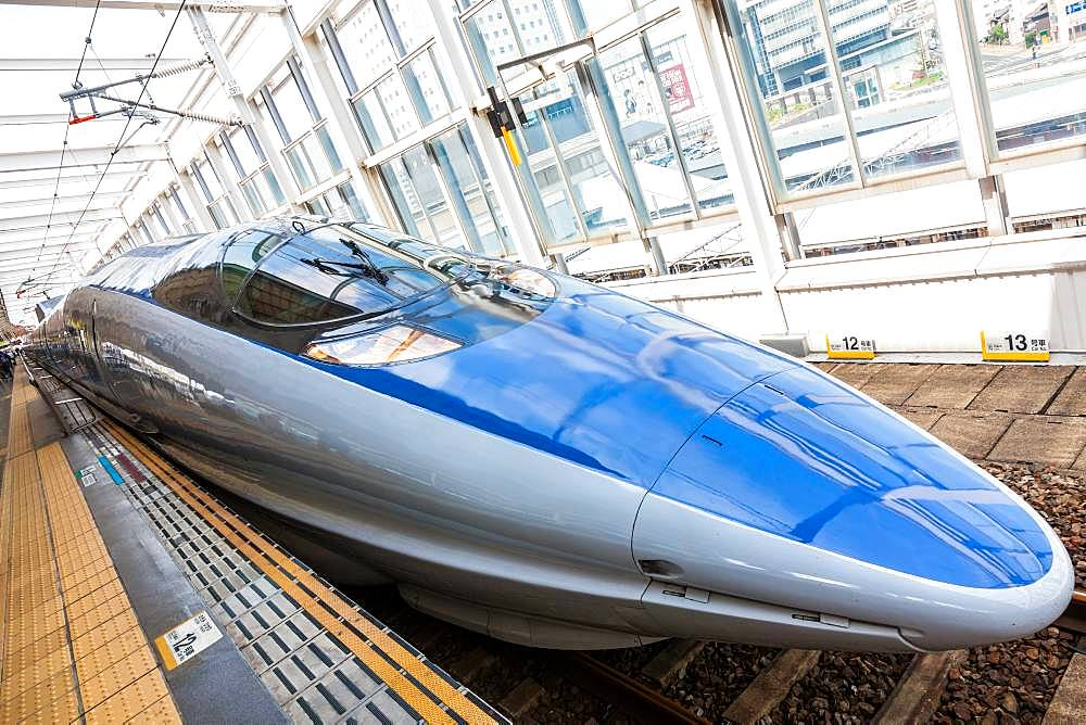 Blue Shinkansen Bullet Train at the platform of Tokyo Station, Japan