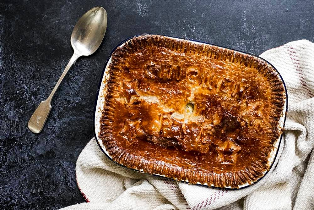High angle close up of freshly baked Chicken Pie and silver spoon