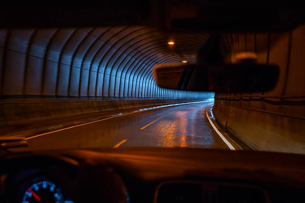 Driver's view, driving through a road tunnel, Lofoten Islands, Norway