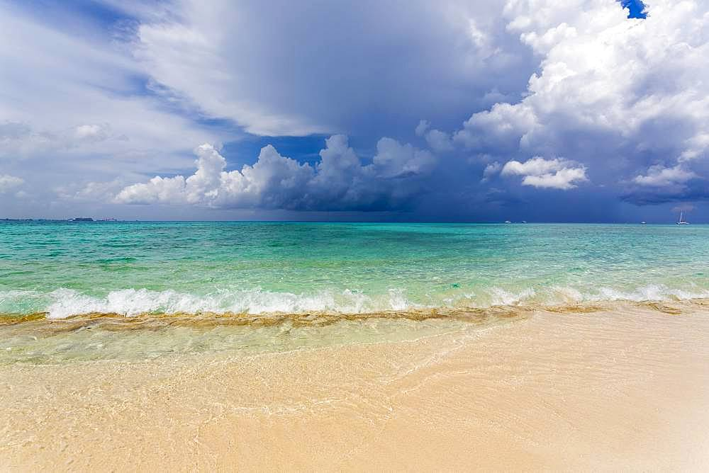 A beach on an island, and view over turquoise sea, Grand Cayman, Cayman Islands