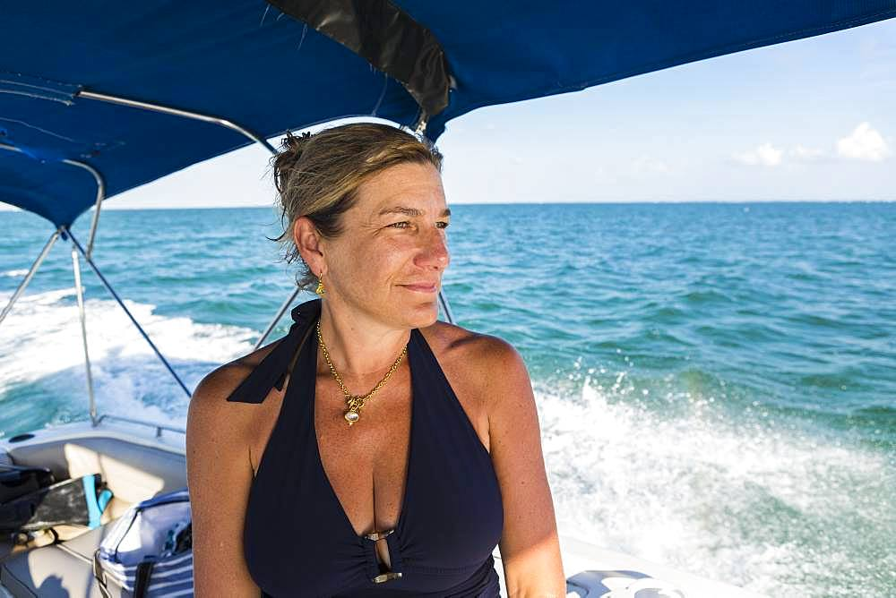 Smiling adult woman on a boat, Grand Cayman, Cayman Islands