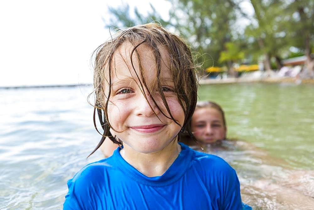 Smiling 5 year old boy in the ocean, Grand Cayman, Cayman Islands
