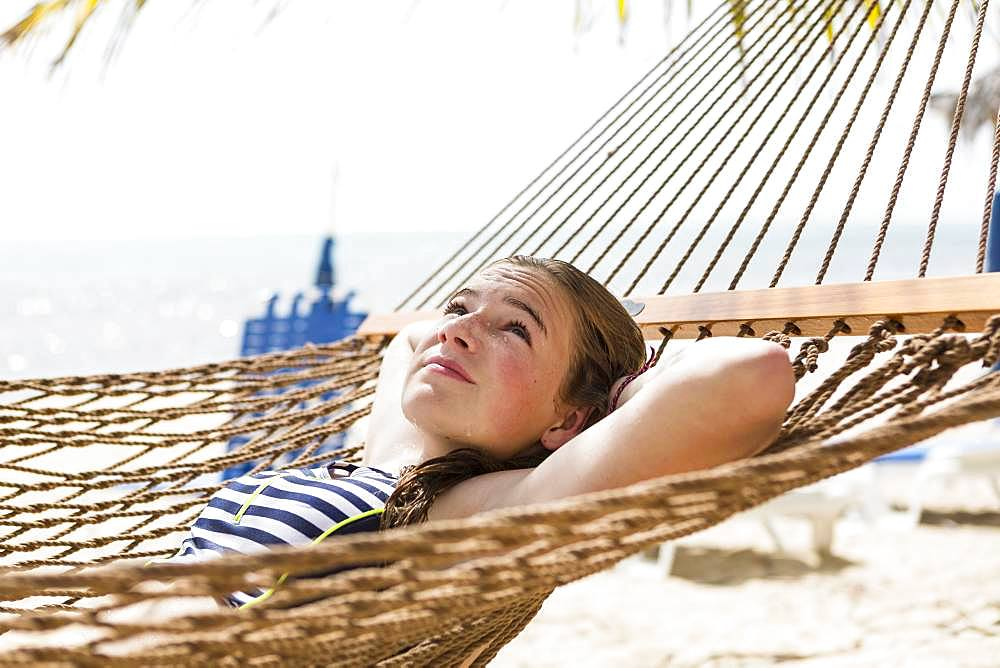 A teenage girl in hammock , Grand Cayman, Cayman Islands