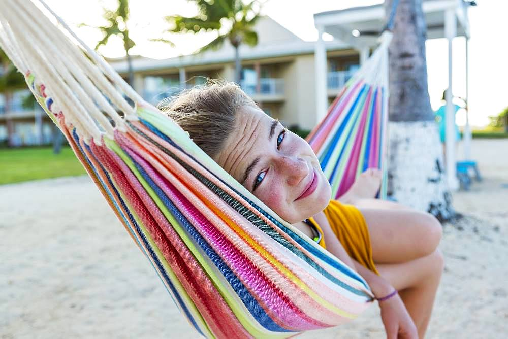 A teenage girl resting in hammock, Grand Cayman, Cayman Islands
