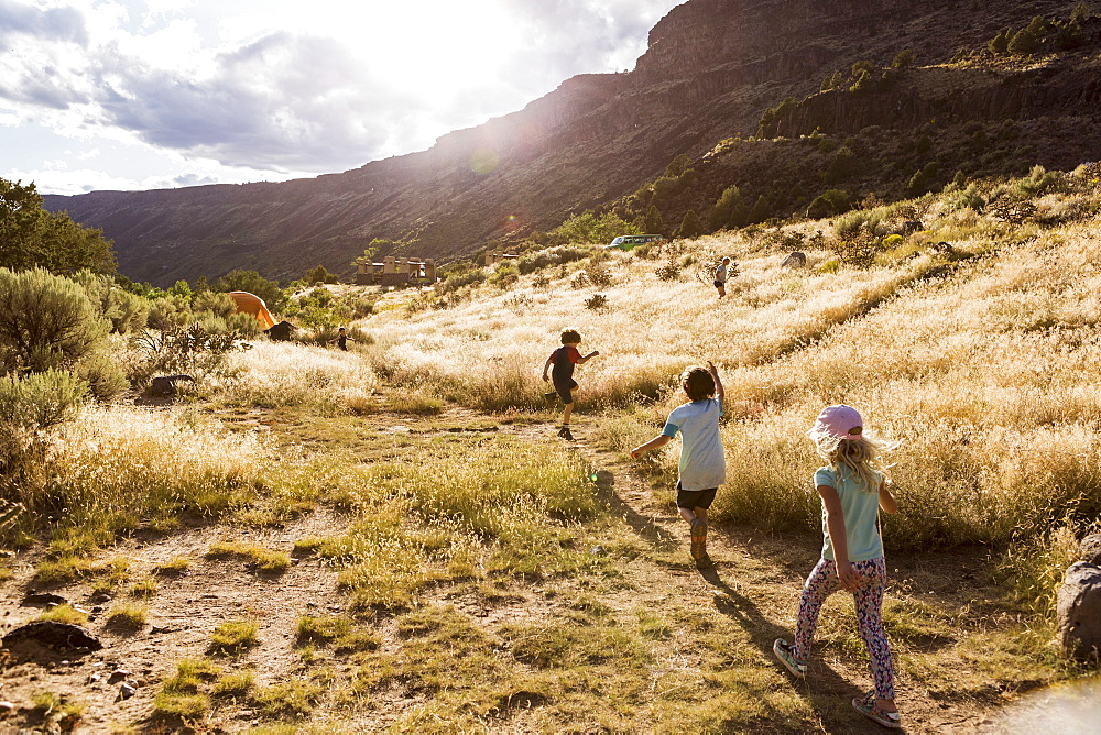 children hiking at sunset, Pilar, NM