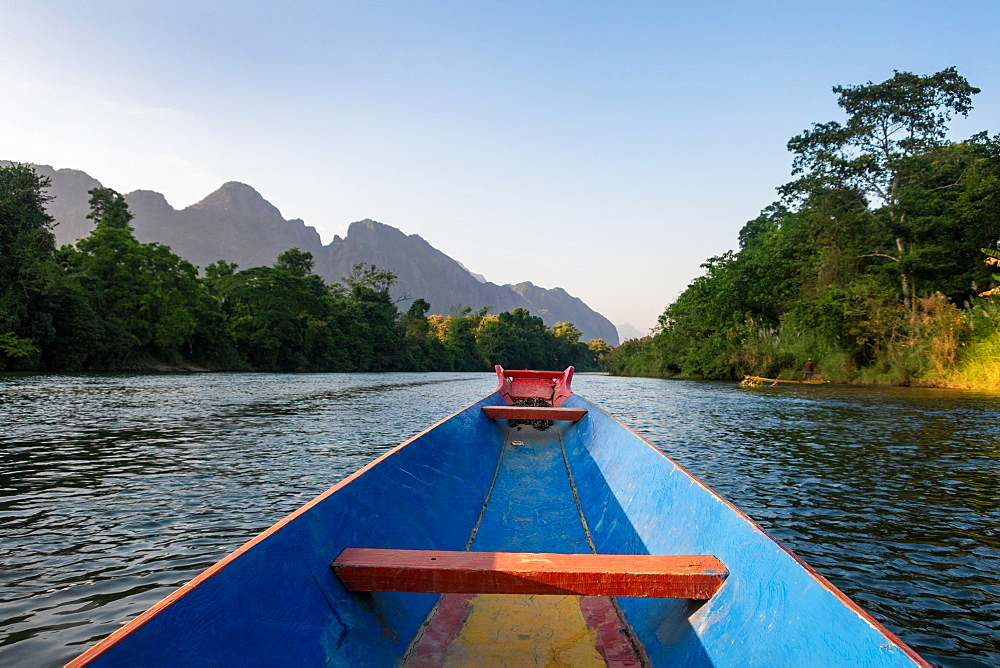 Nam Song River, a boat on the water at Vang Vieng, Laos, Laos