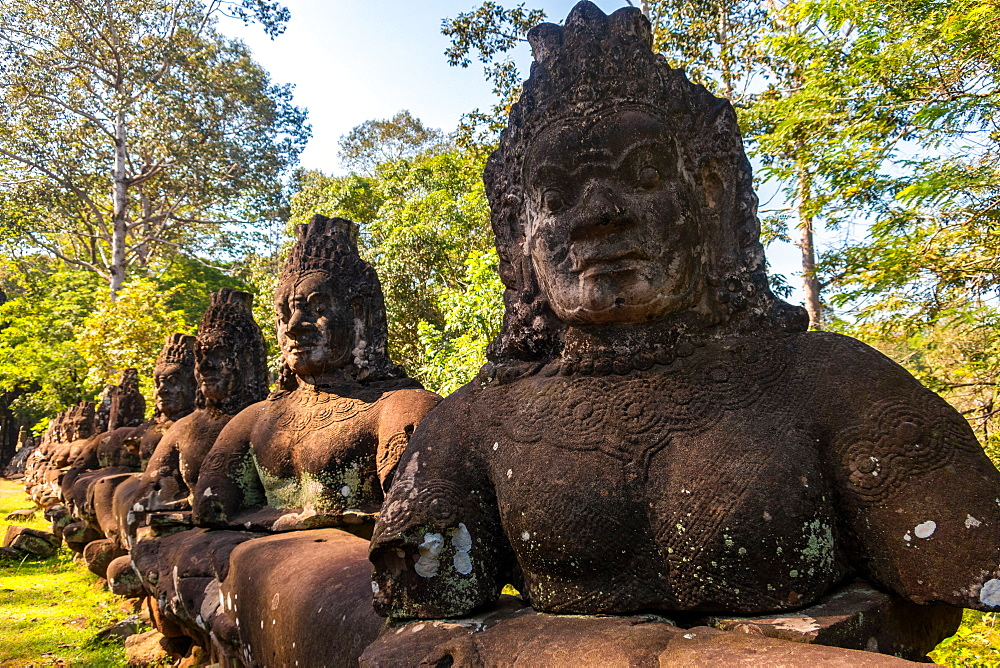 Statues at the entrance to Angkor Thom, Cambodia
