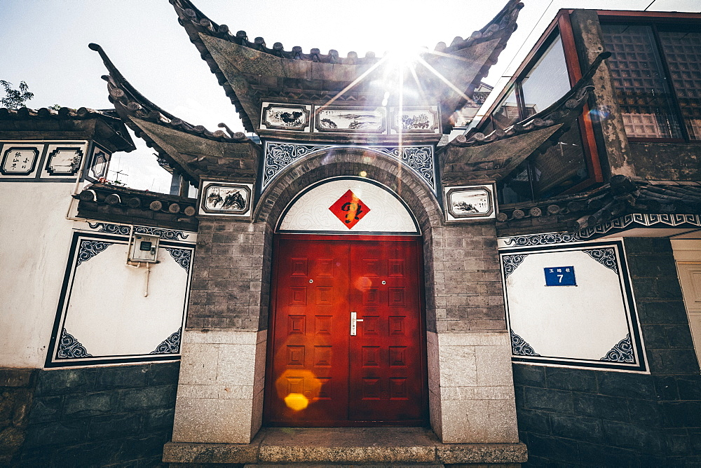 Exterior view of front door and roof of a traditional Chinese residential building, China