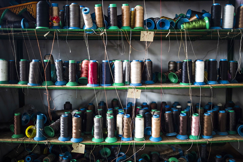Close up of shelves of colorful thread for sewing shoe soles in a factory, Vietnam, Binh Duong