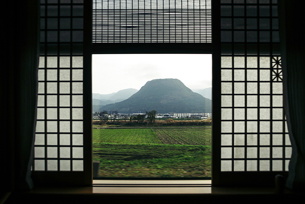 View out of the window of a luxury train, mountain landscape, Kyushu, Japan