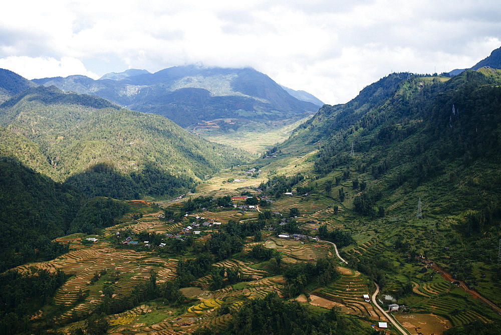 Landscape with valley and mountains under a cloudy sky, Vietnam